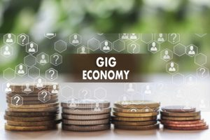 GIG ECONOMY on the touch screen with a  blur financial background .The concept GIG ECONOMY