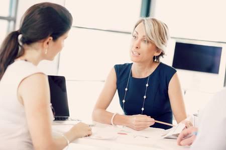 two women meeting worker