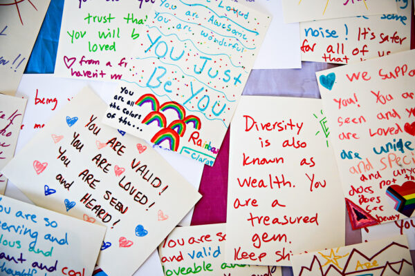 """Notes of Love"" are displayed on a table at Kalico Art Studio in support of the LGBTQ+ community hosted by the Glacier Queer Alliance in Kalsipell on March 31, 2021. Hunter D'Antuono 